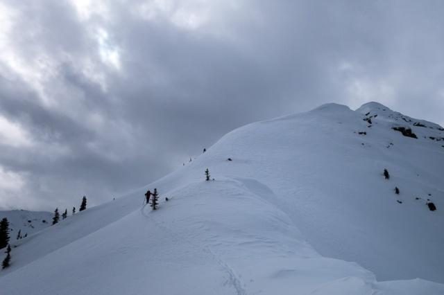 Ryan breaks trail up the summit ridge.